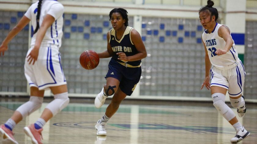Mater Dei Catholic's Chloe Webb (shown in an earlier game) had 13 points and 18 rebounds in the Crusaders' win over Bonita Vista on Friday.