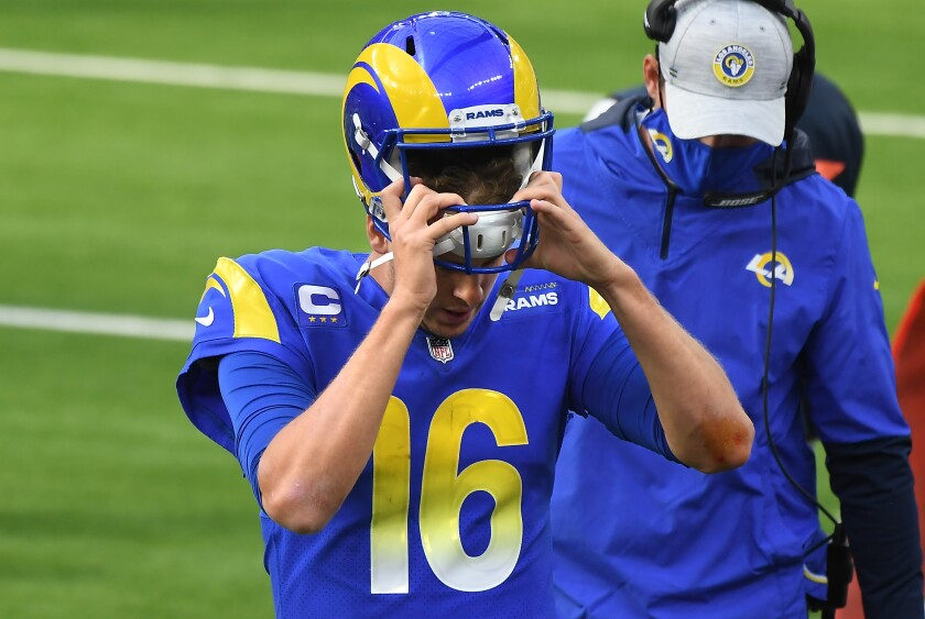 Rams quarterback Jared Goff takes off his helmet after having a pass intercepted against the 49ers at SoFi Stadium.