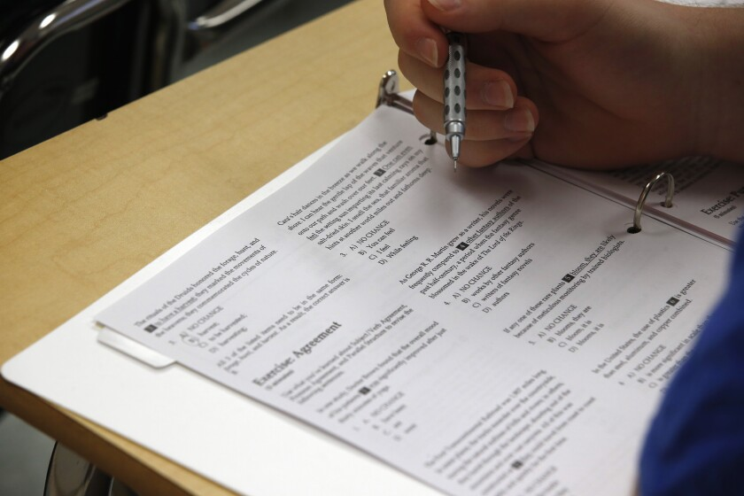 A student looks over questions during a college test preparation class at Holton Arms School in Bethesda, Md.