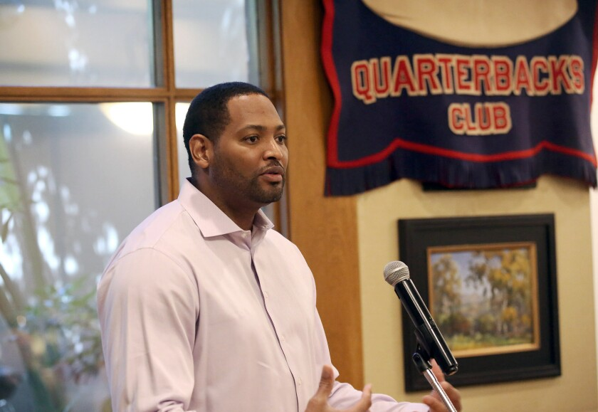 Former NBA player Robert Horry, who won seven championships, addresses the audience at Tuesday's Glendale YMCA Quarterback Club meeting at Oakmont Country Club in Glendale.