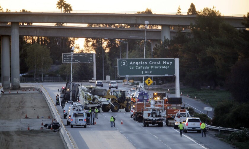 Clean-up efforts continue after a big rig on the 210 Freeway near La Ca–ada Flintridge overturned Wednesday morning, triggering a full shutdown of the eastbound lanes.