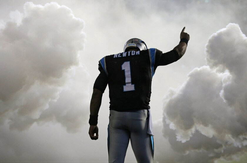 Carolina Panthers' Cam Newton (1) is introduced before an NFL football game against the Indianapolis Colts in Charlotte, N.C., Monday, Nov. 2, 2015. (AP Photo/Chuck Burton)