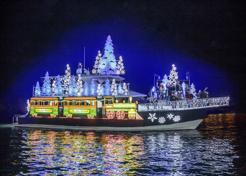 The Newport Beach Christmas Boat Parade, which each year has around 100 lighted and decorated sailboats, yachts, canoes and kayaks, runs Dec. 18-22 this year.