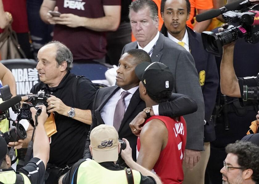 Toronto Raptors president Masai Ujiri walks with guard Kyle Lowry after the Raptors won the 2019 NBA Finals.