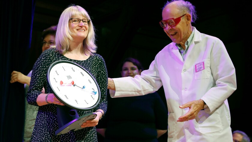 Susanne Akesson accepts the Ig Nobel Prize in physics from Nobel laureate Dudley Herschbach. Her work helped explain the behavior of insects.