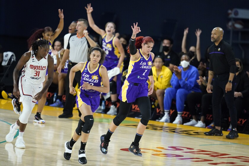 Los Angeles Sparks center Amanda Zahui B (1) signals after making a three-point basket during the first half of a WNBA basketball game against the Washington Mystics Thursday, June 24, 2021, in Los Angeles.(AP Photo/Marcio Jose Sanchez)