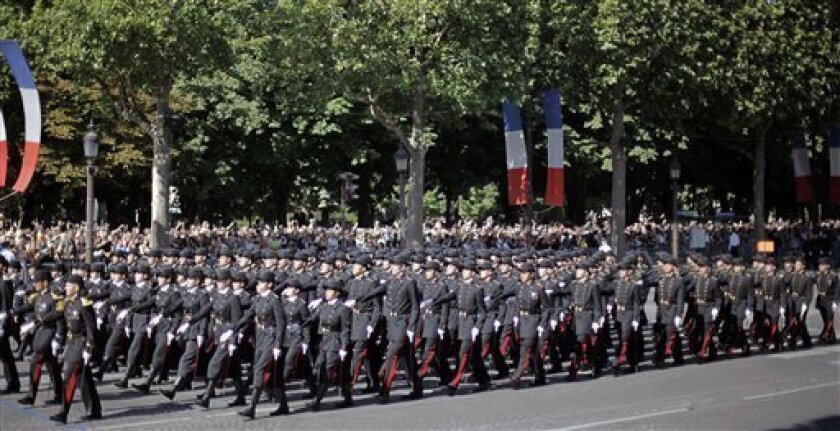 """This July 14 2009 photo shows students of French elite military school Polytechnique parading on Bastille Day in Paris. France is facing a dilemma: Should it force its most elite schools, those that produce presidents, prime ministers and CEOs, to be less elitist about who they let in? The government, intellectuals and activists are clashing over whether to set quotas to ensure that more low-income students attend the """"grandes ecoles,"""" seen as the country's premier path to prosperity and success. (AP Photo/Thibault Camus)"""