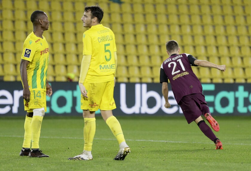 PSG's Ander Herrera, right, celebrates after scoring his teams first goal during the French League One soccer match between Nantes and PSG at Stade de la Beaujoire in Nantes, France, Saturday, Oct. 31, 2020. (AP Photo/David Vincent)