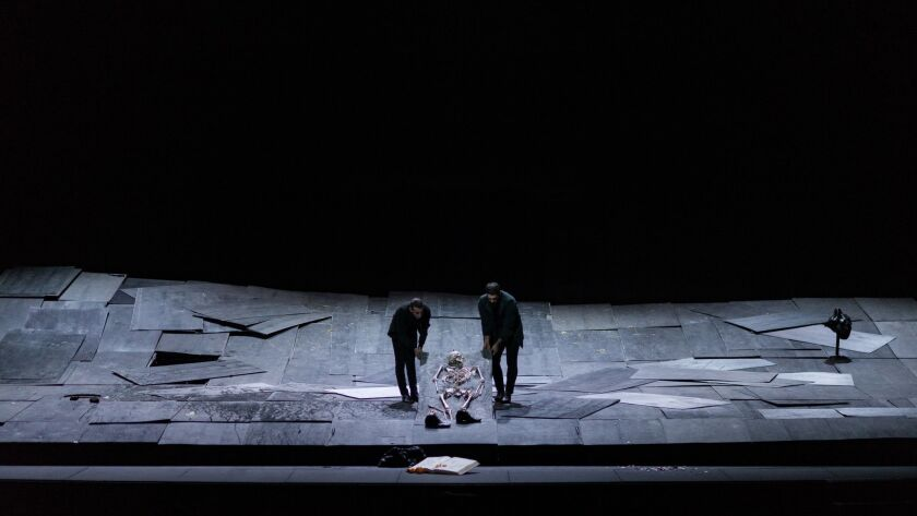 "Drossos Skotis, left, Yorgos Tsiantoulas and a disintegrating skeleton in ""The Great Tamer"" at UCLA's Royce Hall."