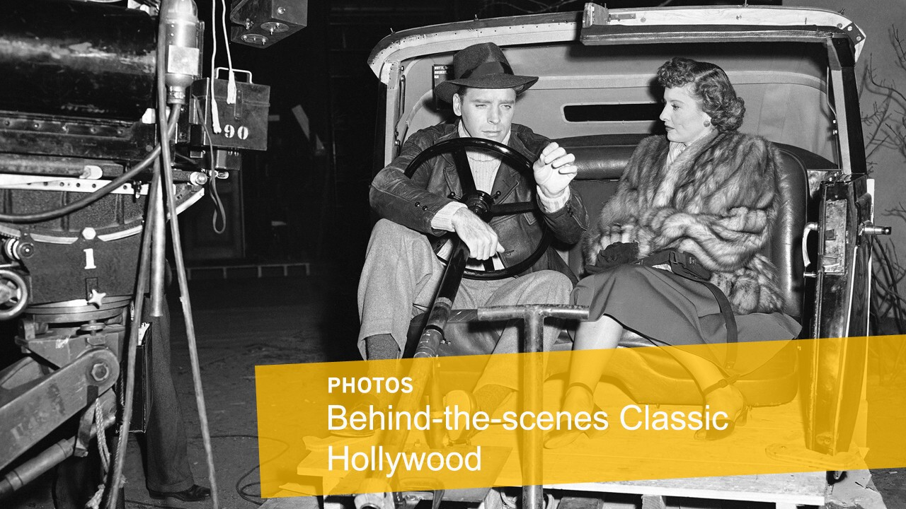 """Film stars Barbara Stanwyck and Burt Lancaster relax on May 19, 1948, in an automobile interior on the set of """"Sorry, Wrong Number"""" in Hollywood."""