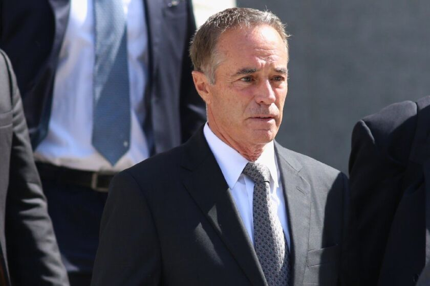 New York Rep. Chris Collins leaves Manhattan Federal Court Aug. 8. Collins is charged with insider trading.