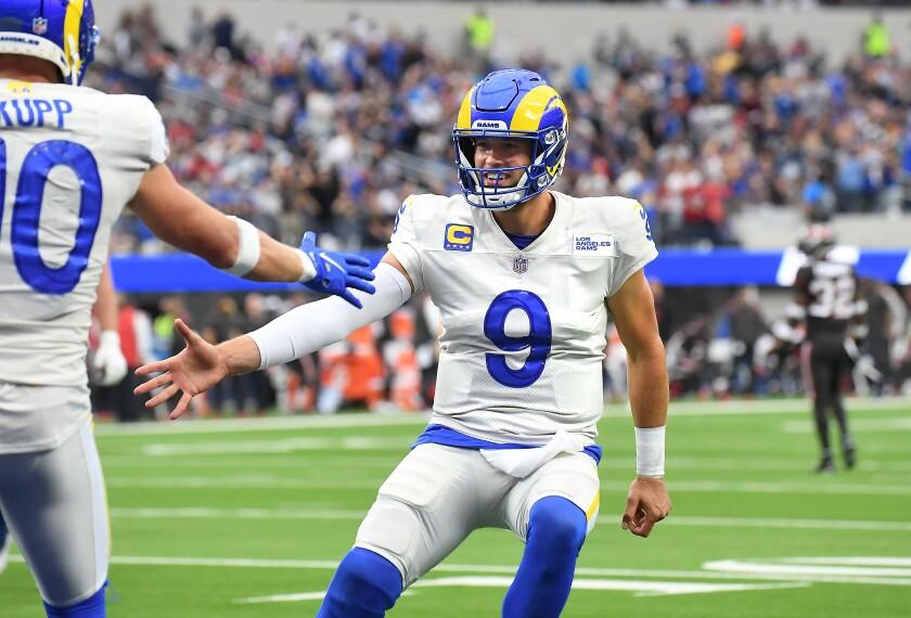 Rams quarterback Matthew Stafford celebrates his touchdown pass to Cooper Kupp on Sept. 26, 2021.
