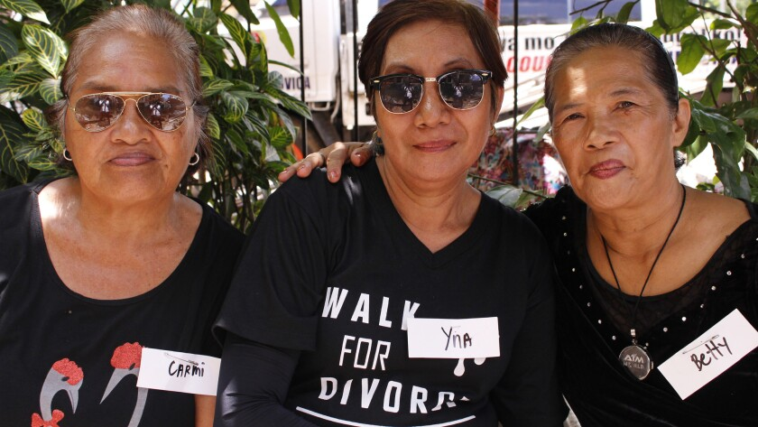 A retired overseas worker, Yna Vertudazo, 60, center, is joined by her friends Carmi Bantilo, 68, and Betty Robianes, 64.