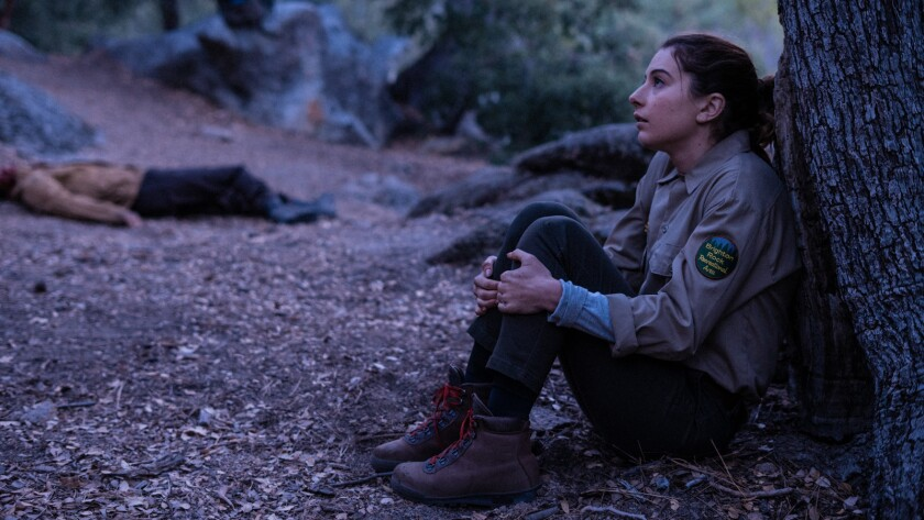 """As the sun sets, Wendy (Karina Fontes) starts to worry about predators of all varieties in the movie """"Body at Brighton Rock."""""""