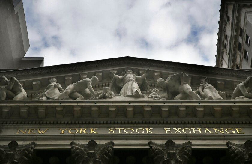 FILE - This Aug. 24, 2015, file photo, shows the New York Stock Exchange. China led gains in global stocks Wednesday, Nov. 4, 2015, on hopes for a Hong Kong-Shenzhen stock trading link that would further open China's financial markets while Japan was powered by a blockbuster share sale. (AP Photo/S