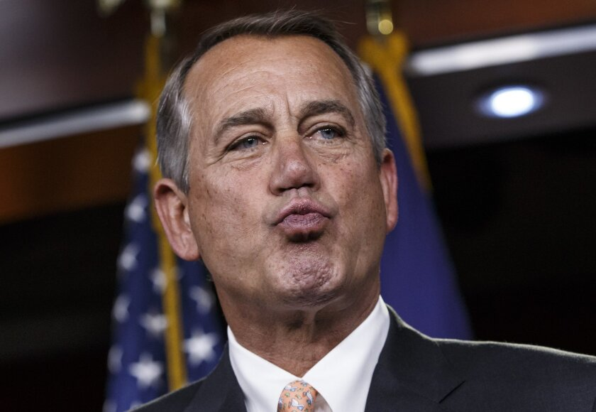 """House Speaker John Boehner of Ohio responds to reporters about the impasse over passing the Homeland Security budget because of Republican efforts to block President Barack Obama's executive actions on immigration, Thursday, Feb. 26, 2015, during a news conference on Capitol Hill in Washington. The House voted last month to end Homeland Security funding on Saturday unless Obama reverses his order to protect millions of immigrants from possible deportation. After Democratic filibusters blocked the bill in the Senate, the chamber's Republican leaders agreed this week to offer a """"clean"""" funding measure, with no immigration strings attached. (AP Photo/J. Scott Applewhite)"""