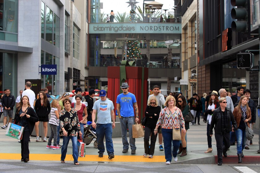Black Friday shoppers are seen walking across the street from Santa Monica Place to the Third Street Promenade in Santa Monica in 2012.