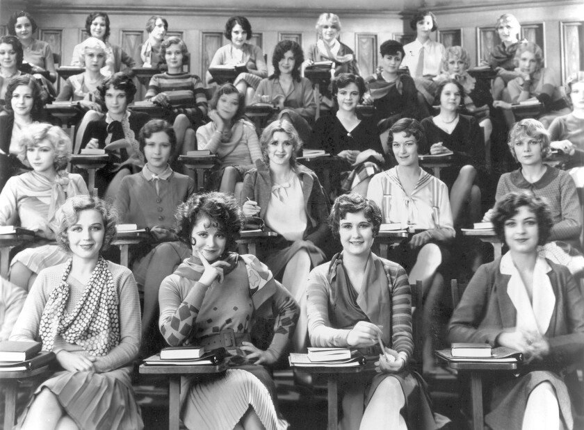 """""""The Wild Party"""" (1929), the first talkie to star 1920's """"It"""" girl Clara Bow, second from left in the first row, was directed by the pioneering female director Dorothy Arzner. Produced by Paramount Studios, it is among 700 titles assumed to be nestled in the vaults of Universal Pictures, which inherited Paramount's 1930s and 1940s film archive from its forebear MCA, which acquired the collection in 1958."""