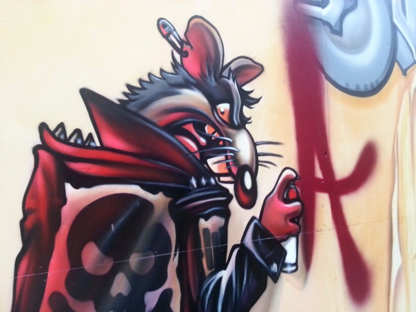 A graffiti rat by Axis at the El Segundo Museum of Art, part of an exhibit that joins contemporary graffiti art with rare books.