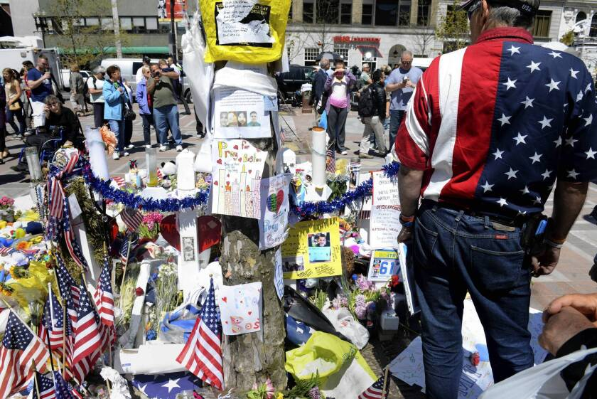U.S. government begins intelligence review in Boston bombing case