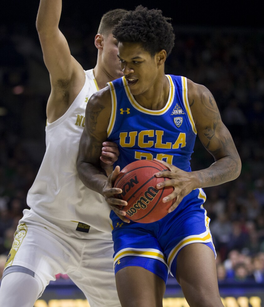 UCLA's Shareef O'Neal is pressured by Notre Dame's Nate Laszewski during a game Dec. 14.