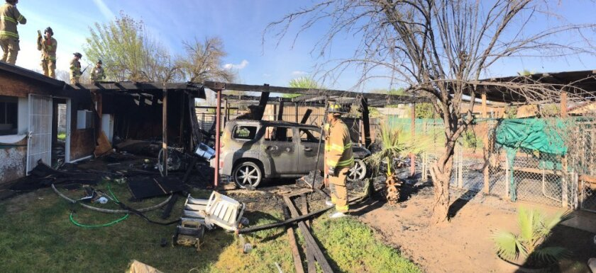 A mirrored headboard started a carport fire Sunday afternoon in Fresno, fire officials said.