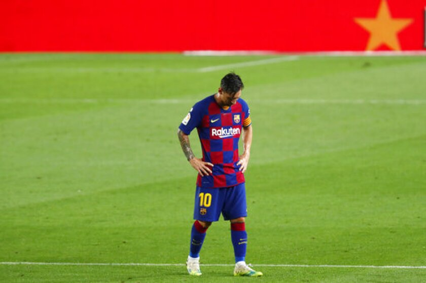 Barcelona's Lionel Messi dejected as walks after the end of a Spanish La Liga soccer match between Barcelona and Osasuna at the Camp Nou stadium in Barcelona, Spain, Thursday, July 16, 2020. (AP Photo/Joan Monfort)