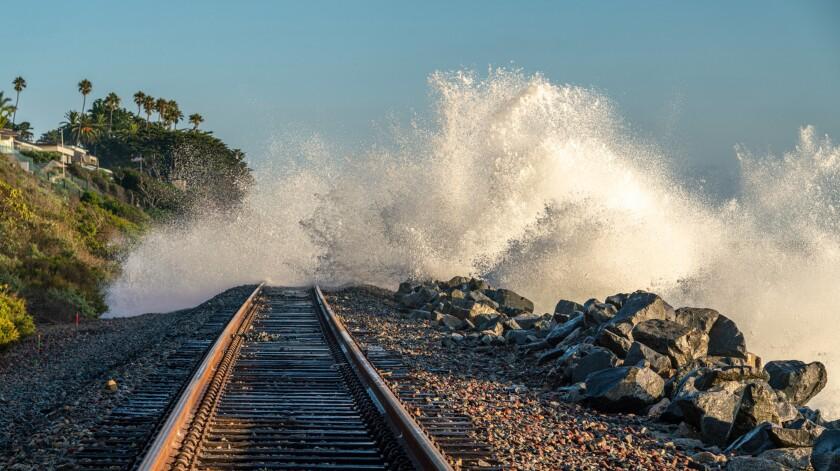 Ocean waves crash over rail tracks in San Clemente.
