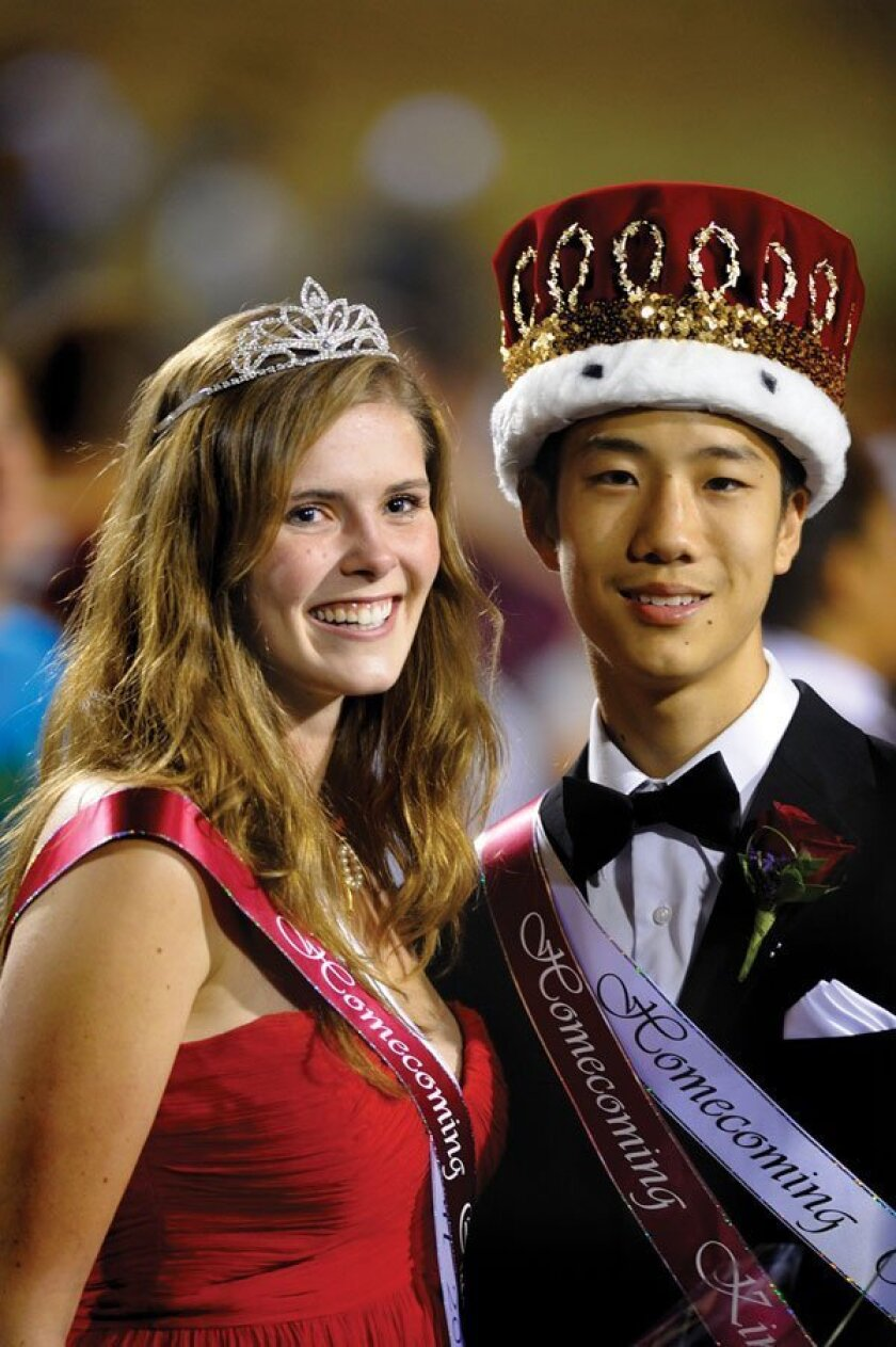 Crowned Torrey Pines High School Homecoming King and Queen were Albert Chen (right) and Charlie Reed (left). Photos by Jon Clark