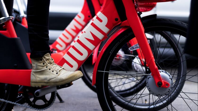 Ride-hailing giant Uber is buying the electric-bike startup Jump Bikes, adding bike sharing to its t