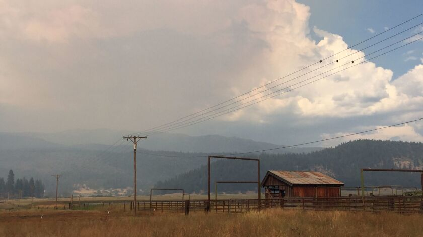 Smoke from the nearby Minerva fire burning in the Plumas National Forest fills the air outside Quinc