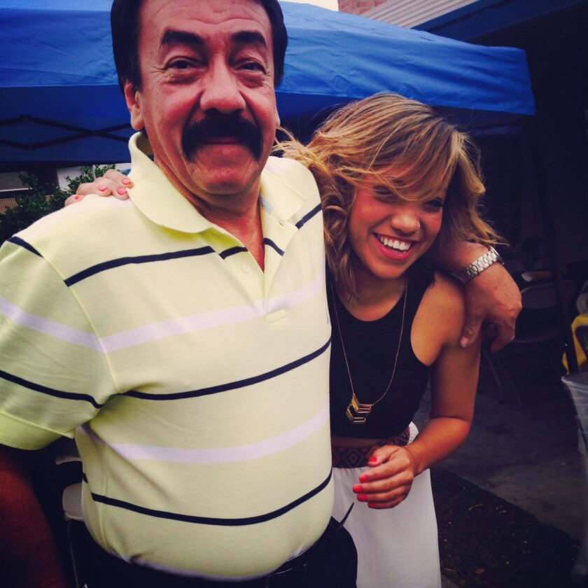 José Roberto Álvarez, shown with his daughter Alisha, is a victim of COVID-19.