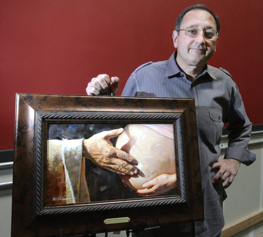 Ron Dicianni stands with a painting that he is distributing  to family planning clinics, OB-GYN offices and abortion providers through his nonprofit foundation that aims to spread a pro-life message.