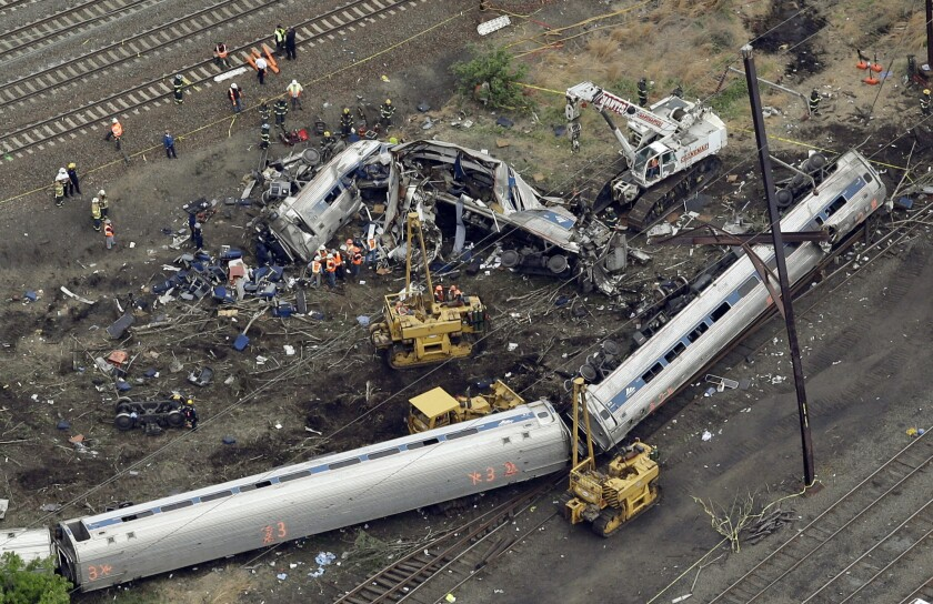 A May 13, 2015, photo of emergency personnel at the scene of the derailment in Philadelphia of an Amtrak train headed to New York.