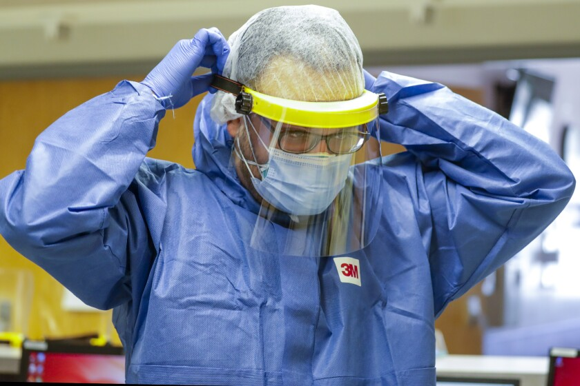 Dr. Imran Siddiqui wears a face shield on the job at Desert Valley Medical Group in Victorville.