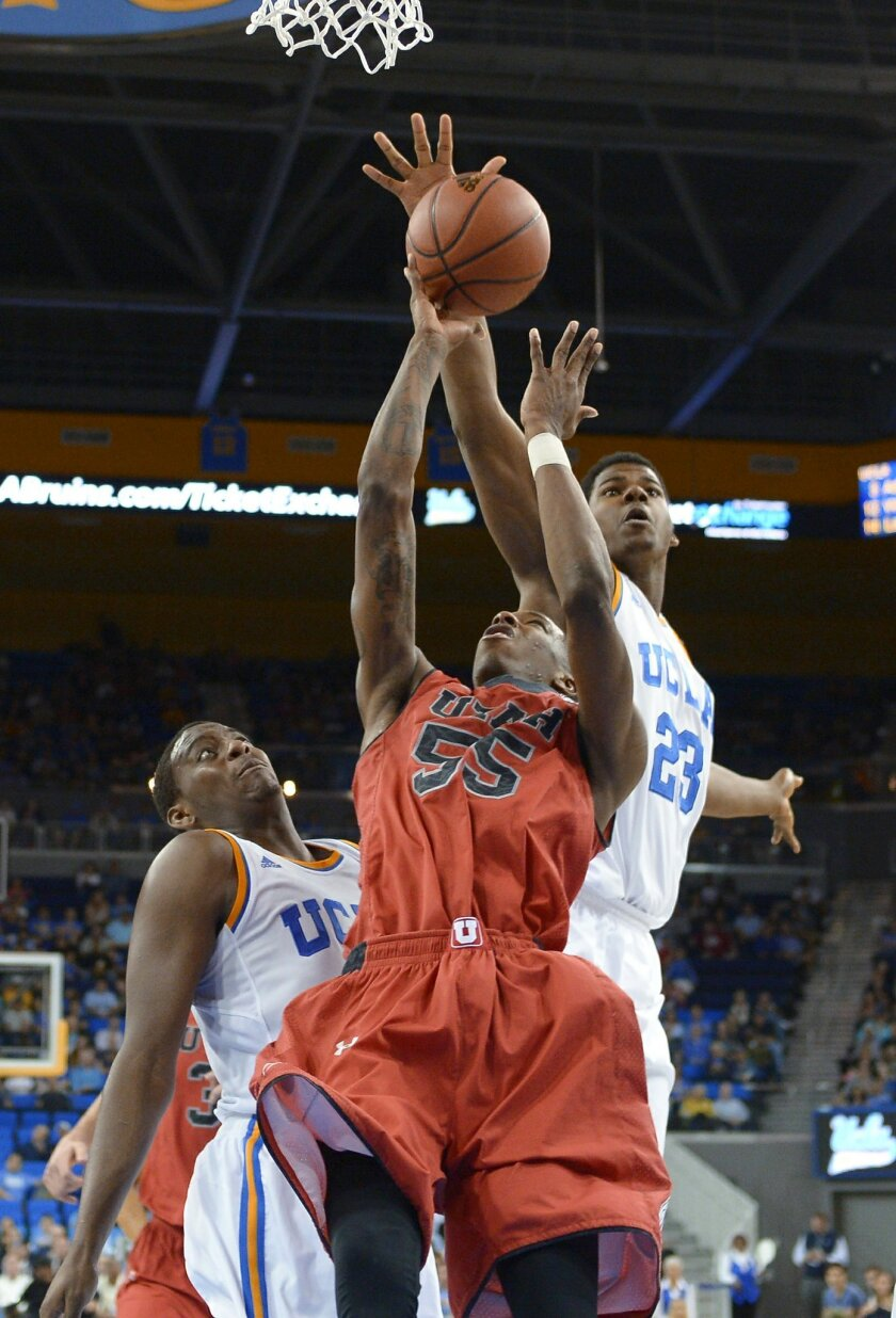Utah guard Delon Wright, center, tries to put up a shot as UCLA guard Jordan Adams, left, defends and center Tony Parker swats the ball away during the second half of an NCAA college basketball game, Saturday, Feb. 15, 2014, in Los Angeles. (AP Photo/Mark J. Terrill)
