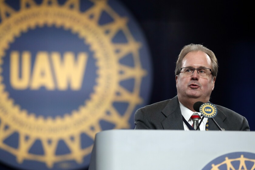 FILE - In this March 11, 2019 file photo, Gary Jones, president of the United Auto Workers union addresses delegates to the union's bargaining convention in Detroit. An expected guilty plea to corruption charges by former United Auto Workers President Gary Jones has been delayed due to the coronavirus and traveling concerns. Jones was to appear in federal court in Detroit on Thursday, March 12, 2020. He's accused of conspiring with UAW cronies to embezzle more than $1 million. (AP Photo/Carlos Osorio, File)