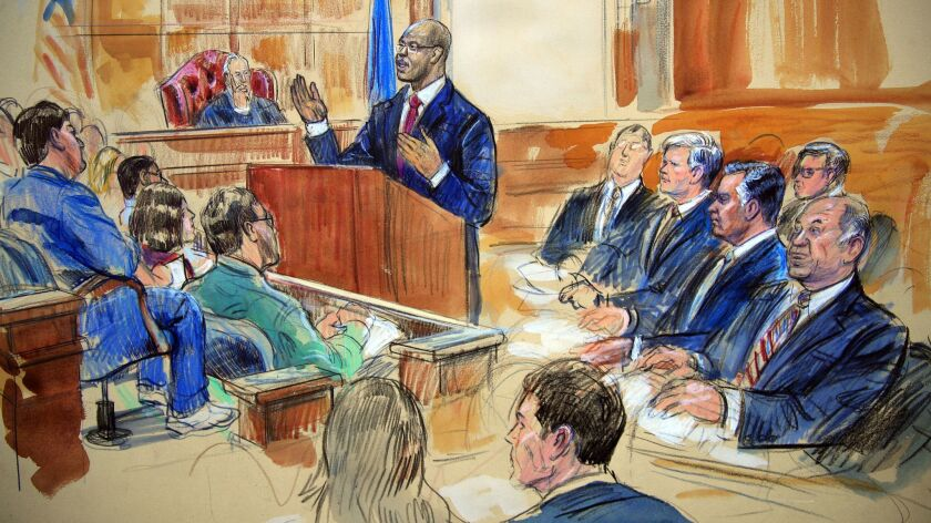 Assistant U.S. Atty. Uzo Asonye, standing, makes his opening arguments in the case against Paul Manafort, seated second from right in the front row in this courtroom sketch.