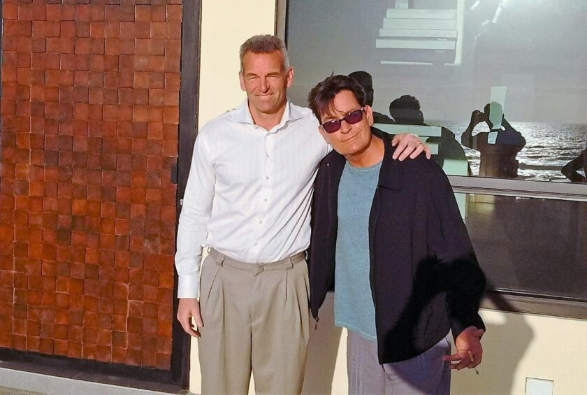 Real estate agent Scott Weier, left, recently sold a home in Rosarito, Mexico, to actor Charlie Sheen.