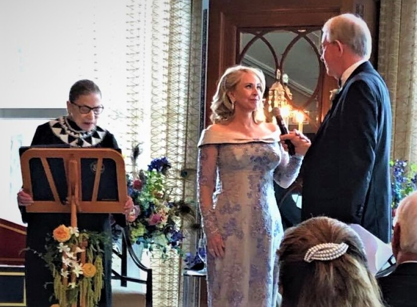 A wedding guest of Pamela Hinchman, center, and La Jolla Music Society head Ted DeDee, right, took this snapshot of the couple's wedding vows Sept. 8 in Chicago, which were officiated by U.S. Supreme Court Justice Ruth Bader Ginsburg, left. Ginsburg's daughter-in-law, Patrice Michaels, and son, James Ginsburg, are friends of the couple.