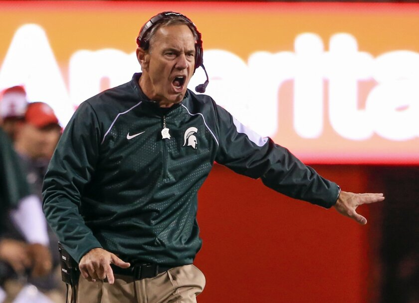 Michigan State head coach Mark Dantonio reacts to a pass interference call during the first half of an NCAA college football game against Nebraska in Lincoln, Neb., Saturday, Nov. 7, 2015. (AP Photo/Nati Harnik)