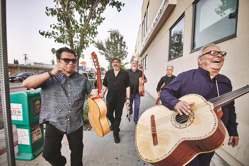 Los Lobos is shown strolling the streets of East L.A., where all but one of the Grammy Award-winning band's members grew up.