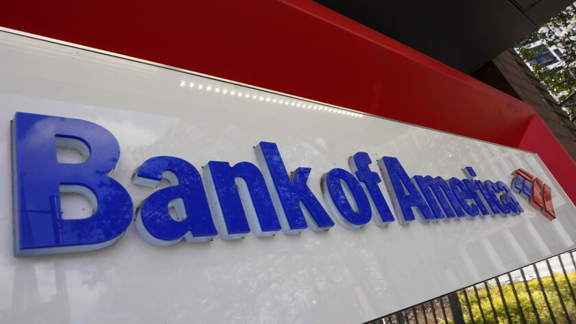 FILE - In this Feb. 10, 2021 file photo, Bank of America signage is shown in Atlanta. Consumer banking giant Bank of America plans to set the minimum wage for all positions at the company to $25 an hour by 2025, the bank said Tuesday, May 18. (AP Photo/John Bazemore, File)