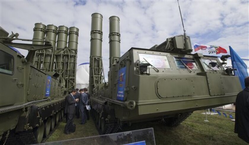 FILE - In this Tuesday, Aug. 27, 2013 file photo, Russian air defense missile systems are displayed at the opening of the MAKS Air Show in Zhukovsky outside Moscow. Russia could expand arms sales to Iran and revise the terms of U.S. military transit to Afghanistan if Washington launches a strike on Syria, a senior Russian lawmaker said Wednesday, Sept. 11, 2013. (AP Photo/Ivan Sekretarev, File)