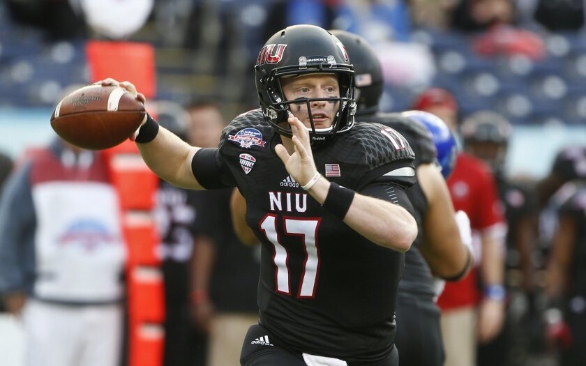 Northern Illinois quarterback Ryan Graham looks to pass against Boise State during the first half of the Poinsettia Bowl NCAA college football game Wednesday, Dec. 23, 2015, in San Diego. (AP Photo/Lenny Ignelzi)