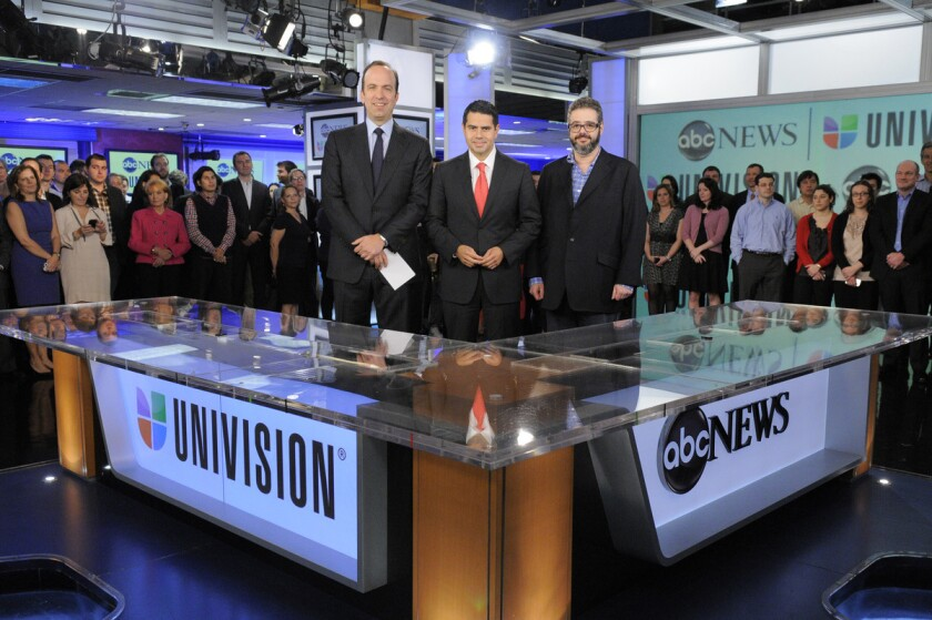 ABC and Univision cheered the formation of the Fusion joint venture in 2012, including then-ABC News President Ben Sherwood, left, who is now president of the Disney ABC Television Group, former Univision Networks President Cesar Conde, center, who is now at NBCUniversal, and Isaac Lee, Univision News president who was the architect and continues to run Fusion.