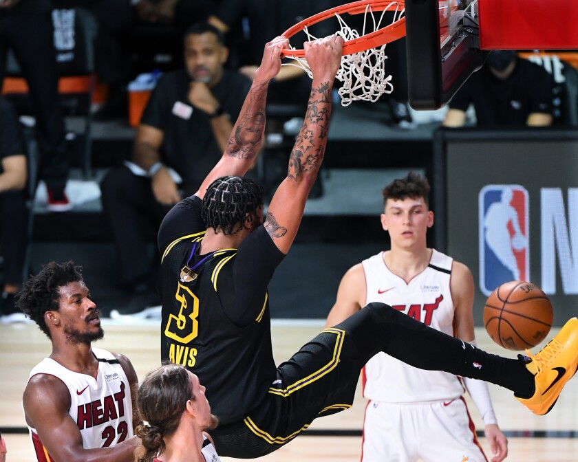 Lakers forward Anthony Davis throws down a dunk in the fourth quarter of Game 2 against the Heat on Friday night.