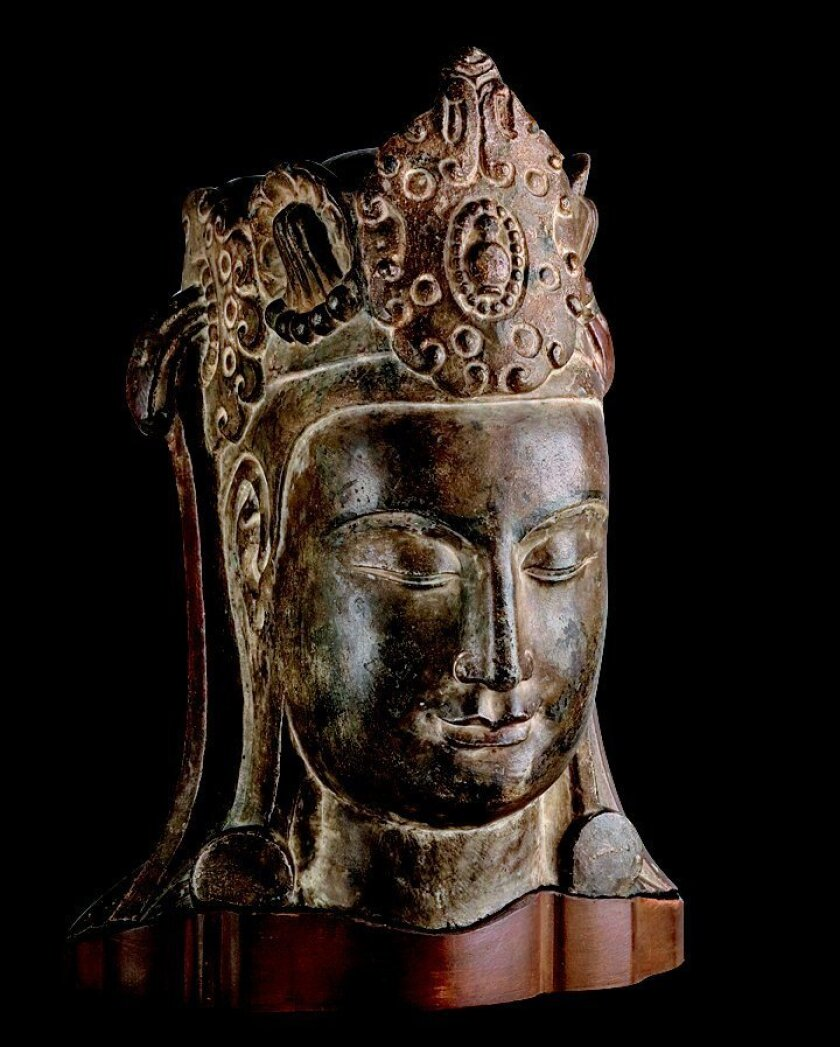 The sculpted head of a Bodhisattva appears in the 'Echoes of the Past' exhibit.