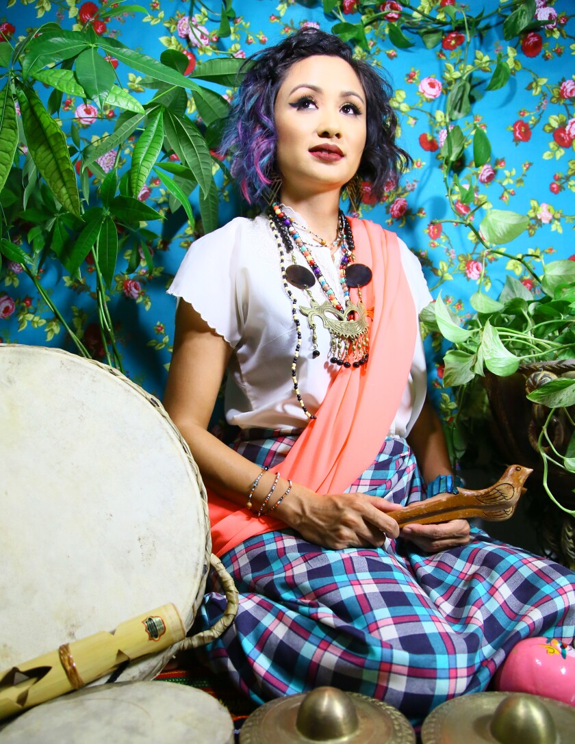 Filipino-American DJ, vocalist and percussionist Gingee uses gongs from the Philippines as part of her mash-up of World Music, hip-hop and electronica.