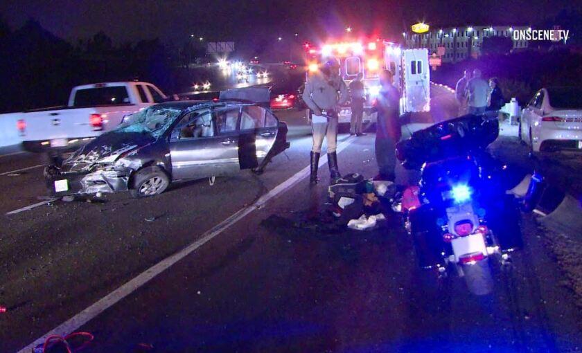 California Highway Patrol officers investigate a major-injury crash Wednesday night on SR-78 near Vista Village Drive.